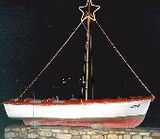 When is Christmas 2014 in Greece and how is it celebrated?: A Christmas boat on Paros
