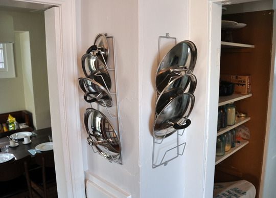 5. Get a rack to store your pot lids. Pot lids always seem to be in the way, don't they? Which is why we love pot lid racks. They're inexpensive, and you can hang them inside cupboards or behind a pantry door if you don't want your lids exposed.