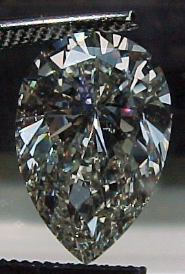 This 4.12-carat pear shaped stone Diamonds By Lauren had up at auction,   starting at $17,000. K-color, SI1 clarity and no fluorescence. Diamonds   by Lauren and Stargate Gems are two of my favorite diamond dealers on   Ebay -- they always have something interesting to look at.