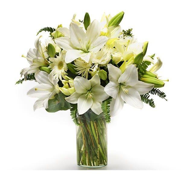 Maravillosa composición de lilium y flores silvestres de temporada. solo en www.floreriasuomnte.cl