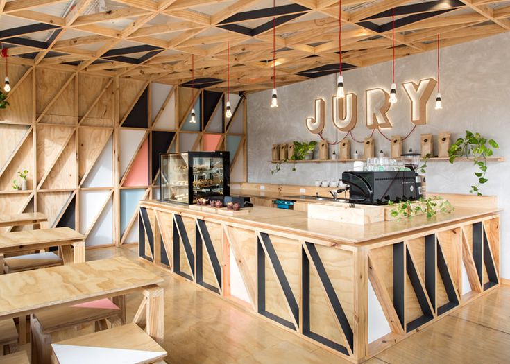Australian prison converted into a cafe lined with colourful tessellating triangles.