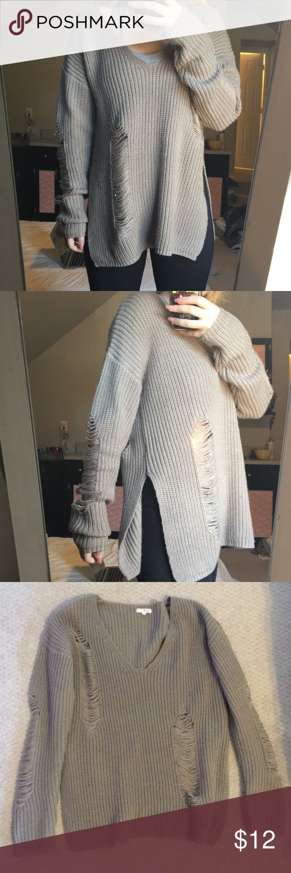 Wet Seal oversized distressed sweater Wet Seal oversized v-neck distressed sweater with slits up each side Wet Seal Sweaters