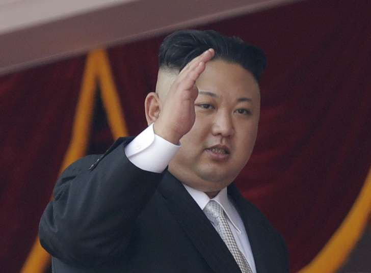 FILE - In this April 15, 2017 file photo, North Korean leader Kim Jong Un waves during a military parade in Pyongyang, North Korea to celebrate the 105th birth anniversary of Kim Il Sung, the country's late founder and grandfather of current ruler Kim Jong Un. A North Korean mid-range ballistic missile apparently failed shortly after launch Saturday, April 29, South Korea and the United States said, the second such test-fire flop in recent weeks but a clear message of defiance as a U.S…