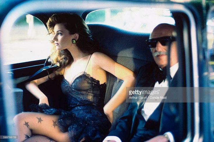 News Photo : Inside car, older, tuxedo-clad, male model next...