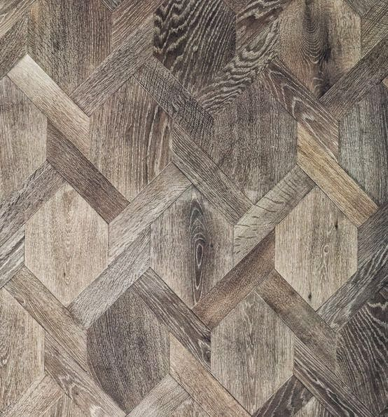 gorgeous wood inlay floor. this could be a cool art project. put a large photo on just the hexagons then put the other links on in a grey color . could look like your looking through a fence.