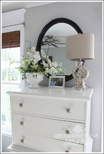 I love this idea, simple - yet elegant. And you could have any kind of lamp, mirror, plant and picture to your taste