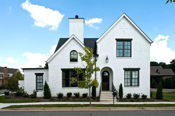 White Painted Brick House Black Exterior Window Trim Exterior Traditional With White Brick Siding Painted White Brick Houses Facade House House Paint Exterior