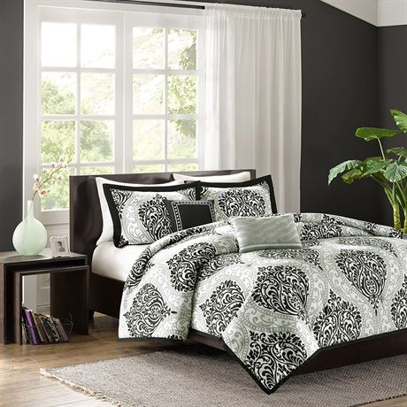 Senna is the perfect way to make a fashion statement in your bedroom. The large black and gray damask print creates a dramatic look with this comforter. Two embroidered decorative pillows are included in this comforter set for a finished look.