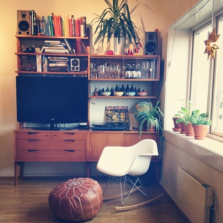 This is my home - #eames #Rival #teak #shelf #norwegian #scandinacvian #books #moroccan #puff #cathrineholm #Bowls #glasses #plants #clock #turntable #globe #matryoshka dolls #60's #60s