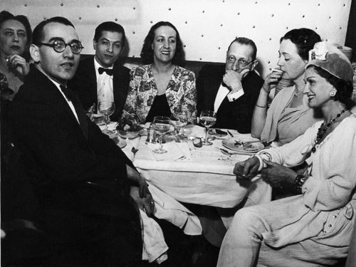 Igor Stravinsky(June 17, 1882 – April 6, 1971), with mouth covered, next to lover Coco Chanel. Russian dancer Serge Lifar is also pictured.