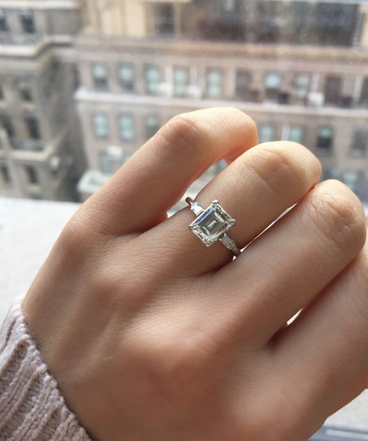 Perfect Emerald cut diamond engagement ring in a platinum setting with baguettes to each side!