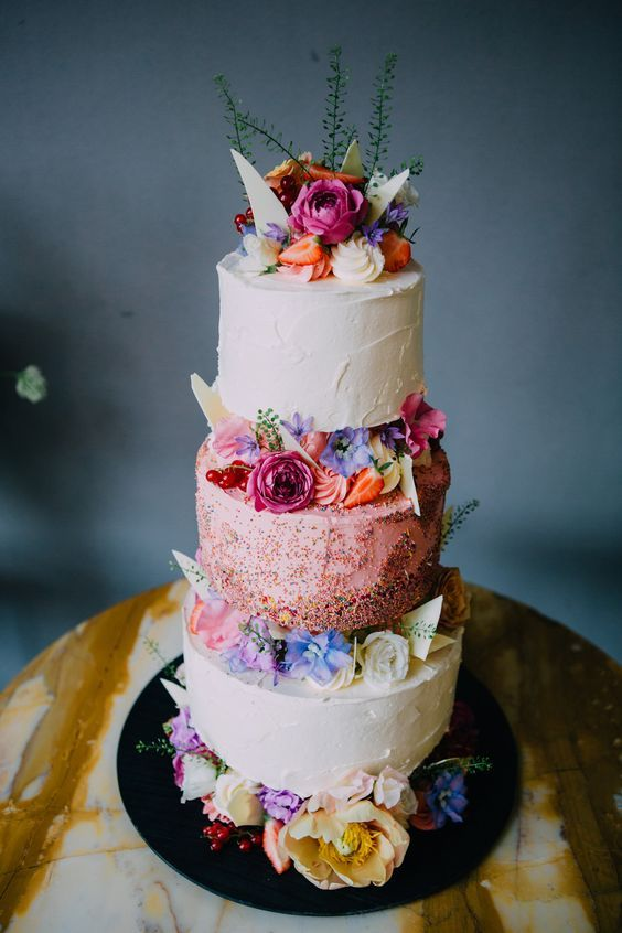 Time for some color! Love the combination of flowers, fruit and those super cool sprinkles. This wedding cake is a party on its own.