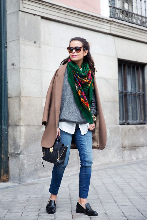 Reach for a brown coat and blue skinny jeans to create a chic, glamorous look. Let's make a bit more effort now and throw in a pair of black leather loafers.  Shop this look for $340:  http://lookastic.com/women/looks/satchel-bag-and-crew-neck-sweater-and-scarf-and-button-down-shirt-and-skinny-jeans-and-loafers-and-coat-and-sunglasses/2713  — Black Leather Satchel Bag  — Grey Crew-neck Sweater  — Dark Green Print Scarf  — White Button Down Shirt  — Blue Skinny Jeans  — Black Leather Loafers…