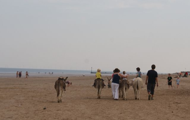 Donkey riding on Mablethorpe Beach, Lincolnshire