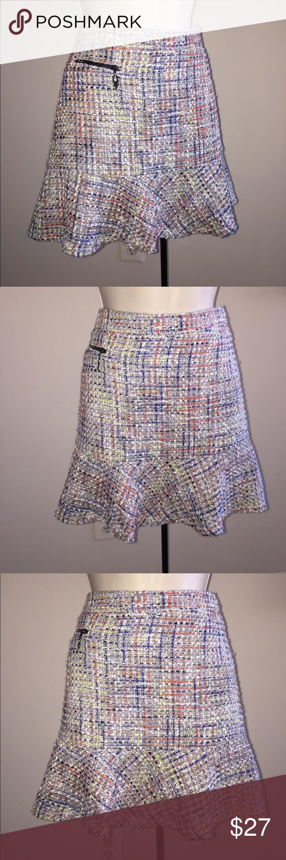 "Multi-colored tweed mini skirt. Tweed trumpet style mini skirt. Small pattern of white and black threads give off a gray color base with multicolored stitching. Waist=14.9""; length= 15"" QMack Skirts Mini"