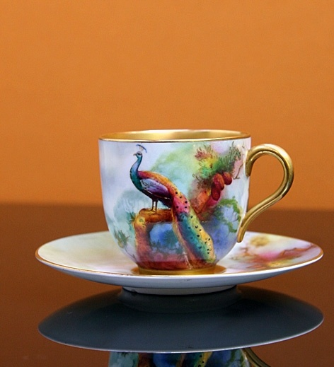Royal Worcester. Gorgeous. I don't even think I would want to drink out of it because it is so stunning.