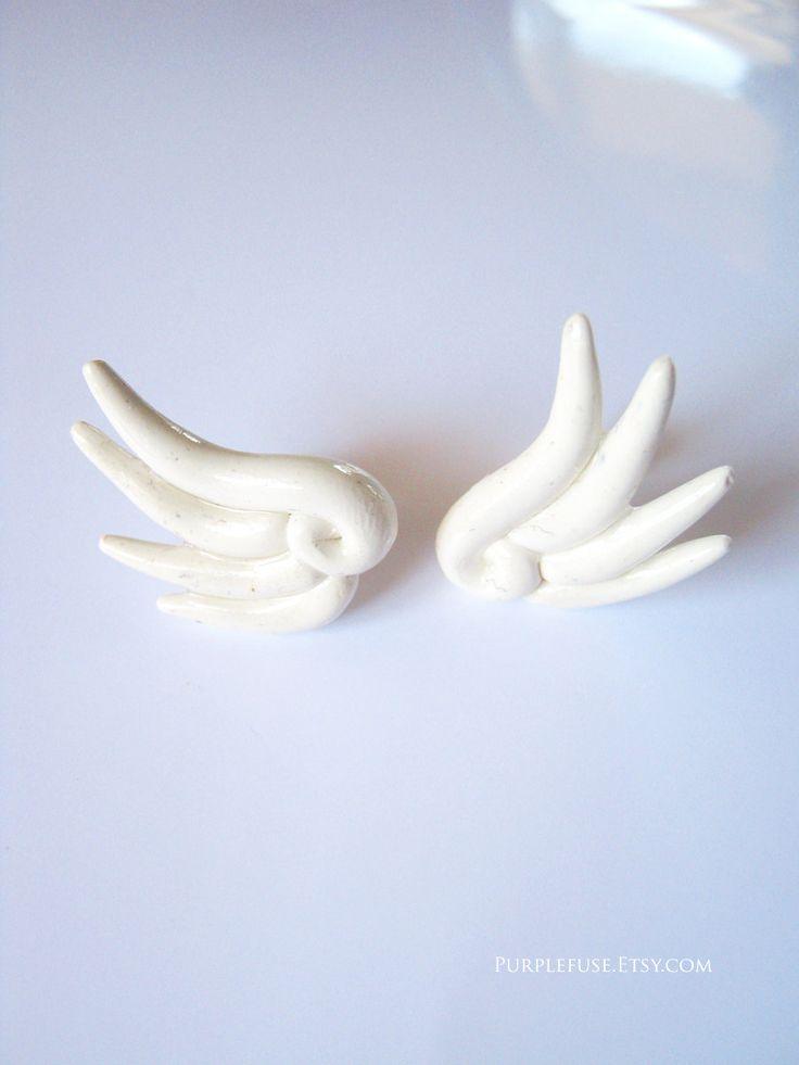 White Chibi Wing Stud Earrings. $9.50, via Etsy.