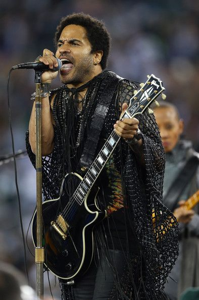Lenny Kravitz Photos Photos - Lenny Kravitz performs at halftime between the New England Patriots v New York Jets game on November 22, 2012 at MetLife Stadium in East Rutherford, New Jersey. - New England Patriots v New York Jets