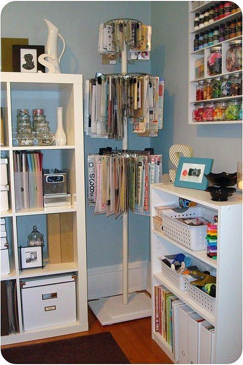 Craft room. Love the shelves of buttons and paint and the rotating pole for stickers
