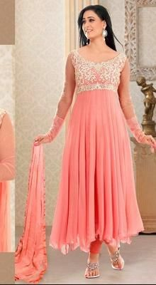 Bring an alluring glow to your face as Shweta Tiwari with this stunning light peach shade faux georgette Anarkali suit. The ethereal embroidered decorative patterned yoke part and flared hemline will make you look like a dainty darling.  #BuyLatestAnarkaliSuits #FashionAnarkaliSuit