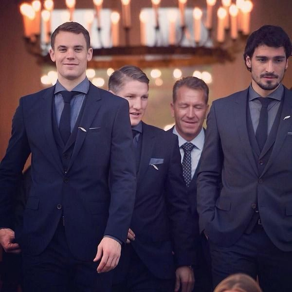 Manuel Neuer, Bastian Schweinsteiger, and Mats Hummels in Hugo Boss suits with Silver Laurel Leaf pins. So proud of them..