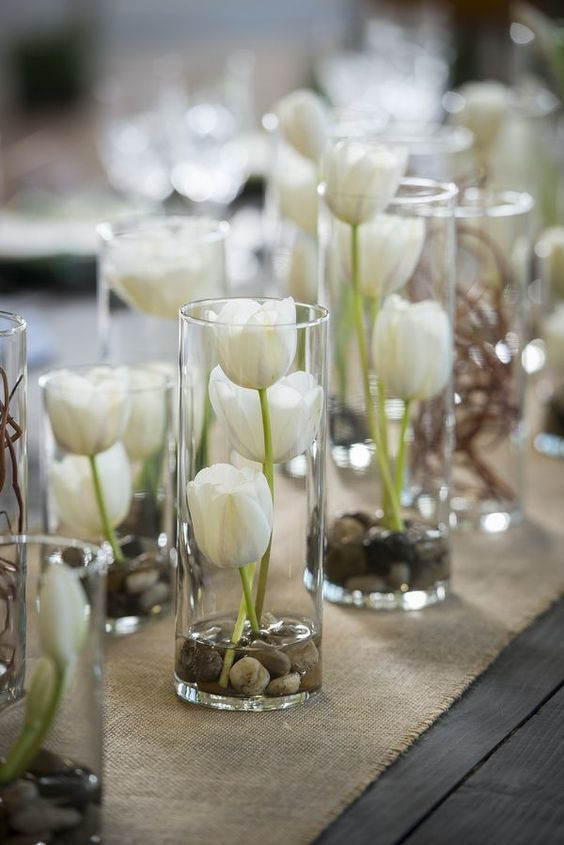 vases filled with white tulips wedding centerpiece /  / http://www.himisspuff.com/simple-elegant-all-white-wedding-color-ideas/9/