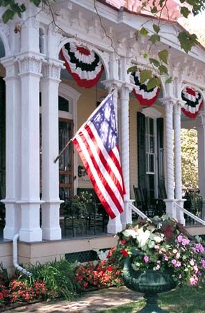 A beautiful home with a show of patriotism - would be great for Independence Day, Memorial Day, Flag Day or any day