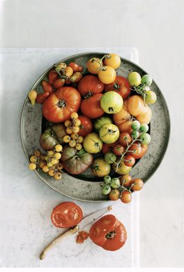Tomatoes are a must. We've grown these since I was a little girl - nothing like eating a roma tomato straight off the vine, still warm from the summer sun.    Organic gardening bonus: tomato helps deter the asparagus beetle, so plant the pair together.