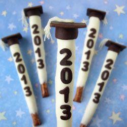 "Graduation Pretzel Pops. Dip pretzel logs in white chocolate then decorate with a chocolate graduation cap and ""2013."""