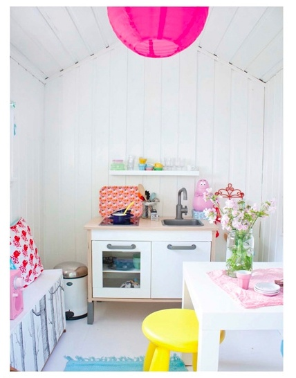 Imagine a full size loft bed over the kitchen set...perfect for a small girls room!