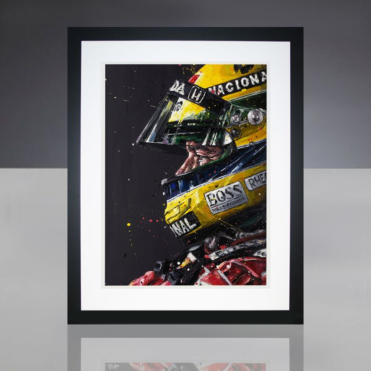 Paul Oz is the buzz word in Formula One art; widely acclaimed for his explosive and energetic artworks and well-respected for his genuine passion for the sport. Oz is also official artist to the Instituto Ayrton Senna.  This giant, museum-quality Paul Oz framed print portrays portrays Ayrton Senna's striking portrait profile; wearing his iconic yellow helmet. Strictly limited to 300 in the edition and hand-signed by Paul Oz, with his hand-written limited edition number (displayed a...