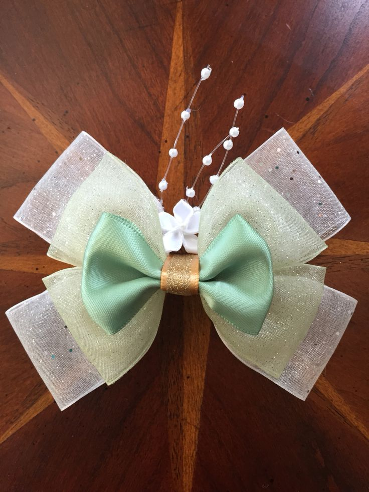 Disney's Princess and the Frog, Tiana hair bow  Handmade by  @missmbowtique