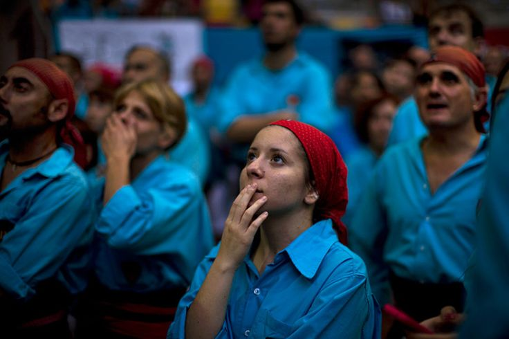 Members of the Castellers de Terrasa watch as others castellers complete. October 2014. Picture: AP Photo/Emilio Morenatti