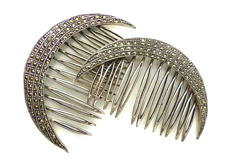 A pair of antique Art Deco decorative hair combs in sterling silver with four layers of marcasite