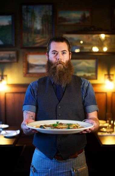 "Joseph McVetty holds one of SE #Portland's Woodsman Tavern's standout dishes, a whole roasted trout in ""crazy water"" (acqua pazzo). #KeepPortlandWeird"