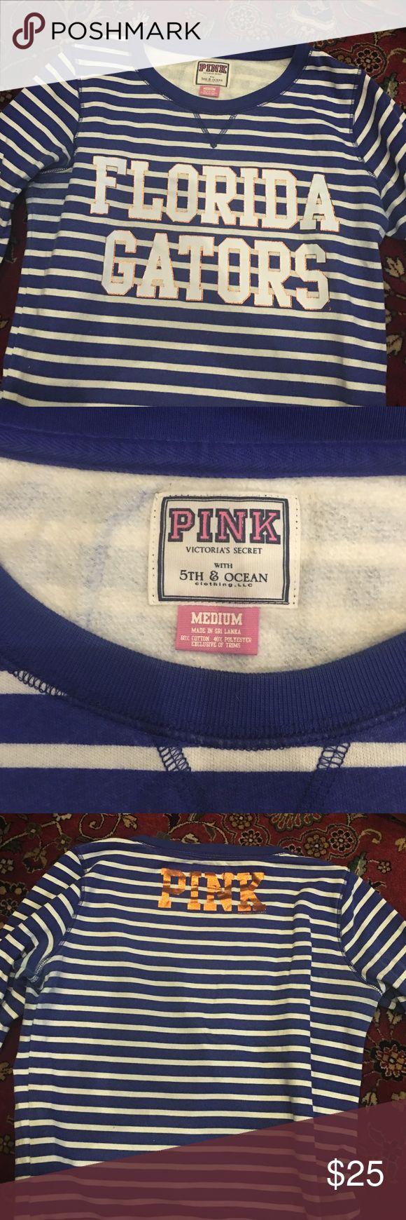 PINK Victoria's Secret crewneck Blue and white striped PINK Victoria's Secret crewneck. Size medium. Condition 10/10. Front: Florida Gators. Back: PINK PINK Victoria's Secret Tops Sweatshirts & Hoodies