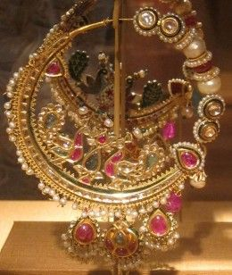 Mughal nose-ring crafted out of gold and studded with various precious gemstones