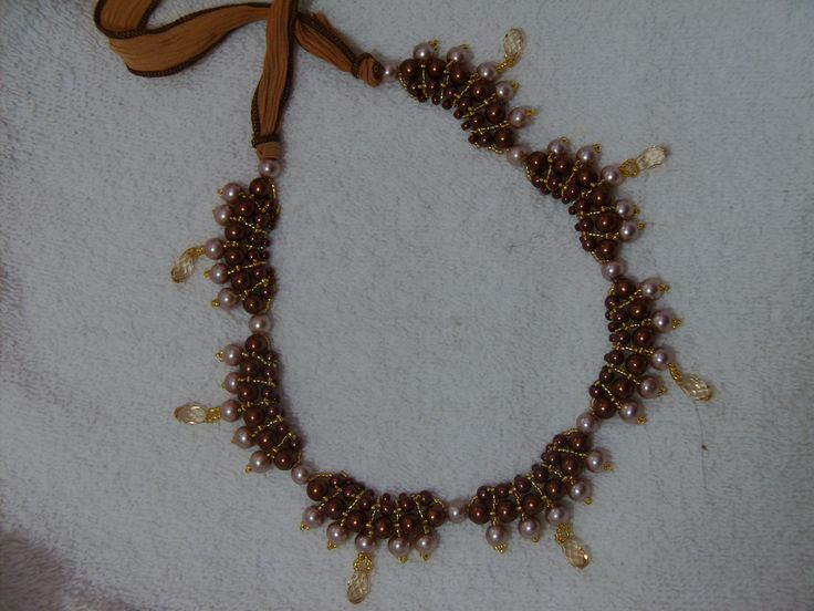 Pearls, seed beads, and crystals tied with silk ribbon.