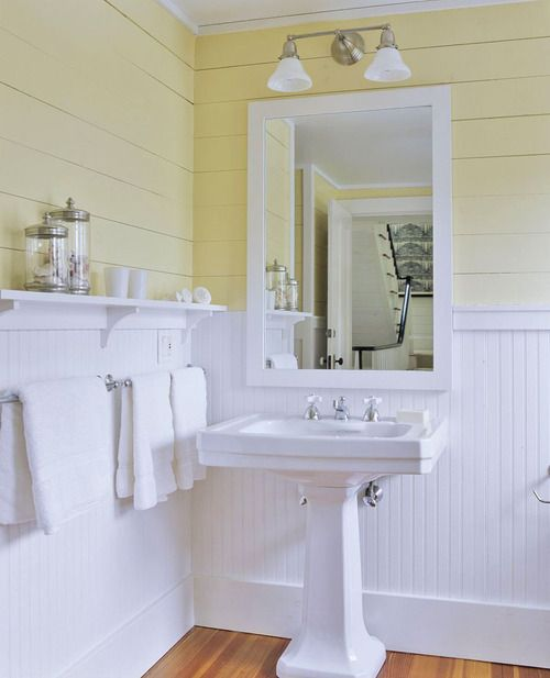 Yellow and white bathroom. Clean and bright.