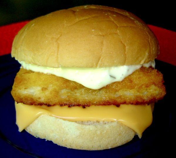 Top Secret Recipes | McDonald's Filet-O-Fish: 2 T Mayo, 2 tsp sweet relish, 2 tsp minced onion, pinch salt, 2 plain hamburger buns, 2 Mrs. Paul's breaded fish portions (square), 1 slice American cheese.