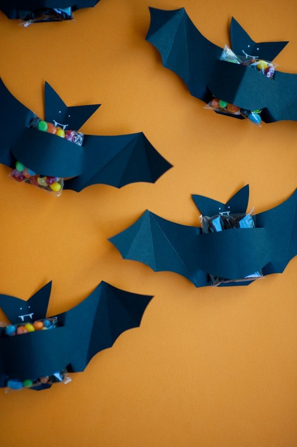 Make a costume for your candy with this tutorial by Oh Happy Day. Create your own bat candy favor for a take-to-school Halloween treat or Halloween party.