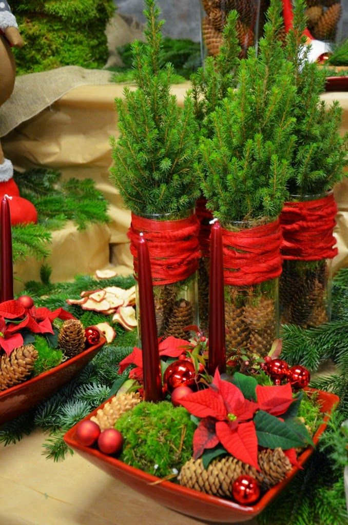 Tiny trees wrapped with strips of red cotton - suziworld:  http://liljorochtulpaner.blogspot.nl/