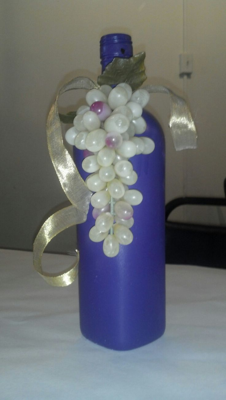 Spray painted wine bottle, fake grapes & ribbon ... Wine themed party!