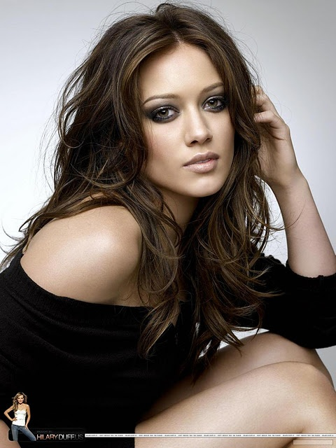 chocolate brown with suuuuper subtle highlights. Hilary Duff