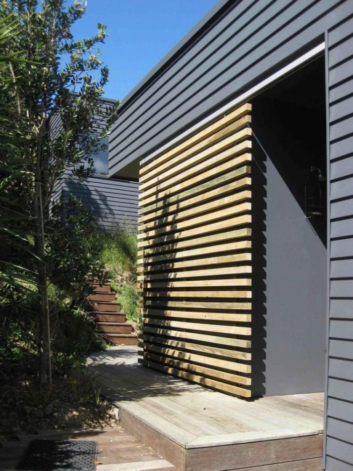 Wood slat sliding door in New Zealand beach house
