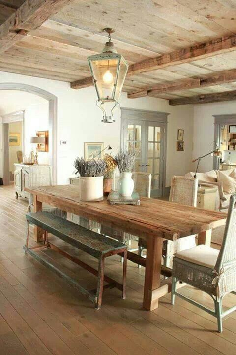 love everything in this pic from the table and chairs and bench, to the wood, to the white walls with grey trim.
