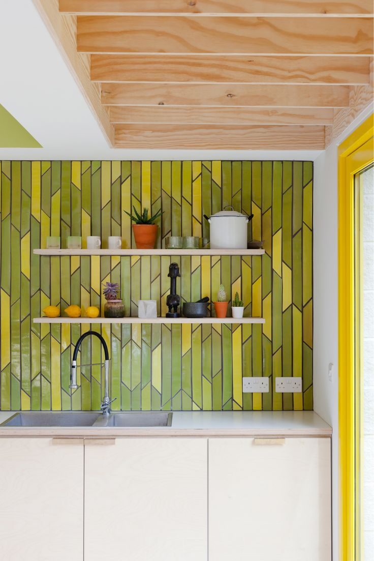 Emma Payne ceramic tiles, bespoke splashback, ply kitchen, brass handles, formica worktop, inset sink