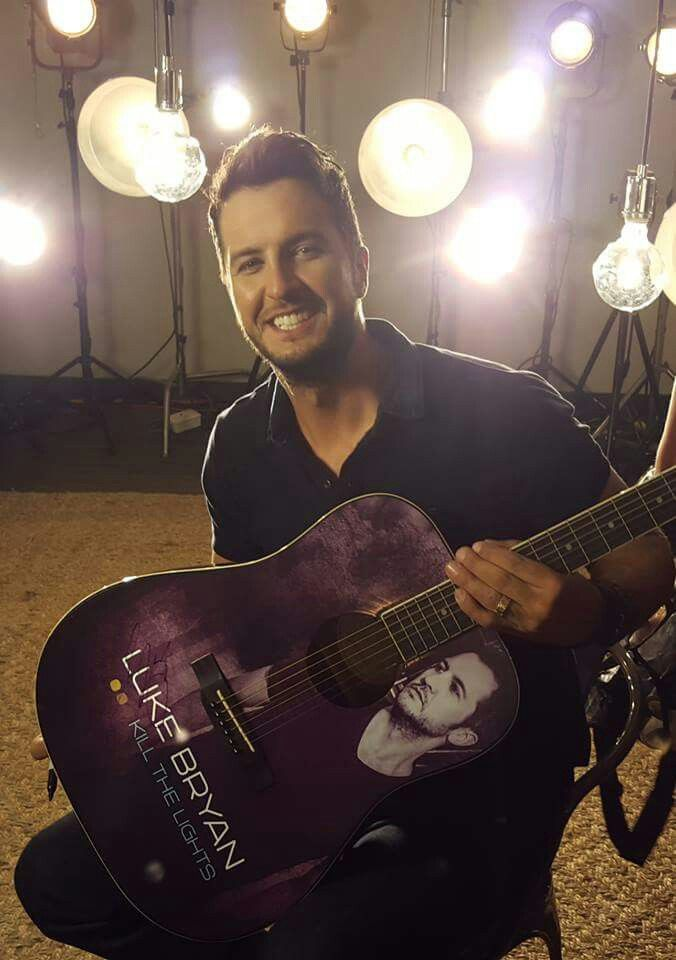 Luke Bryan ❤️.....not only do i love him i need that guitar!!!!