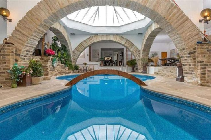 On the market: A sprawling underground home built into the earth by a famous architect has gone on sale for £700,000