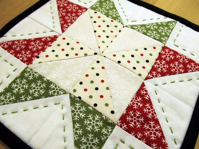 I love the hand quilting that has been done on these cute little Mug Rugs. a perfect activity to occupy my hands while watching something on TV in the evening.  Christmas Mug Rug | Flickr - Photo Sharing!